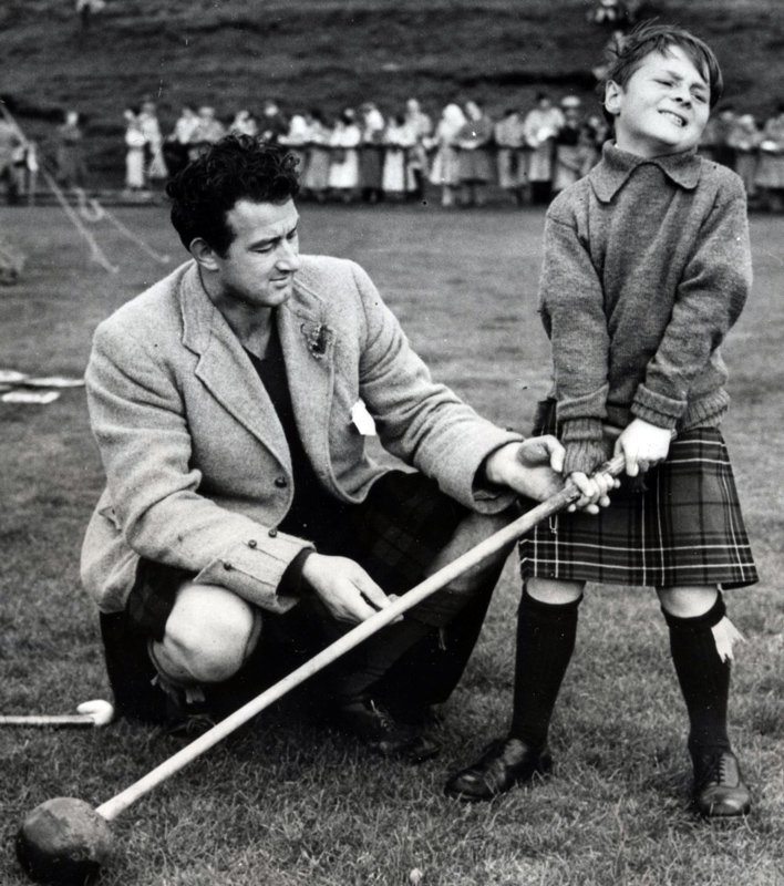 8 year old Sir Lachlan learning to throw a hammer from Jack Hunter at the Argylleshire Gathering in Oban in 1950